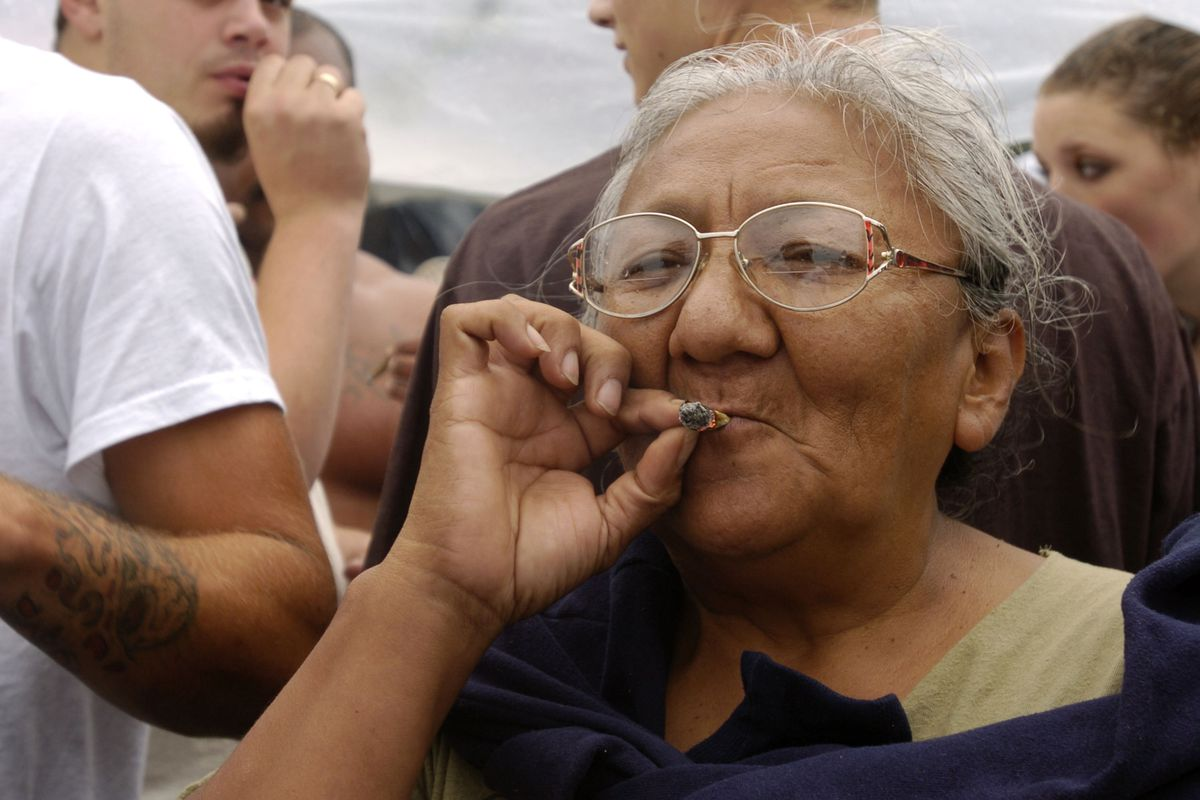 An older woman smokes a joint in Seattle.