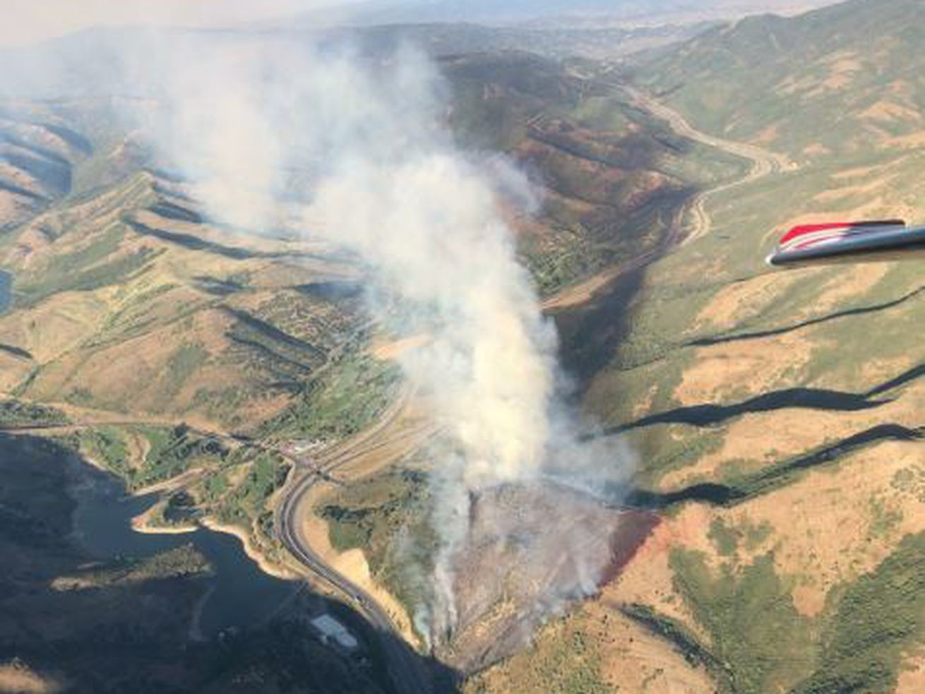Fast-moving fire in Parleys Canyon shuts down I-80, evacuates homes