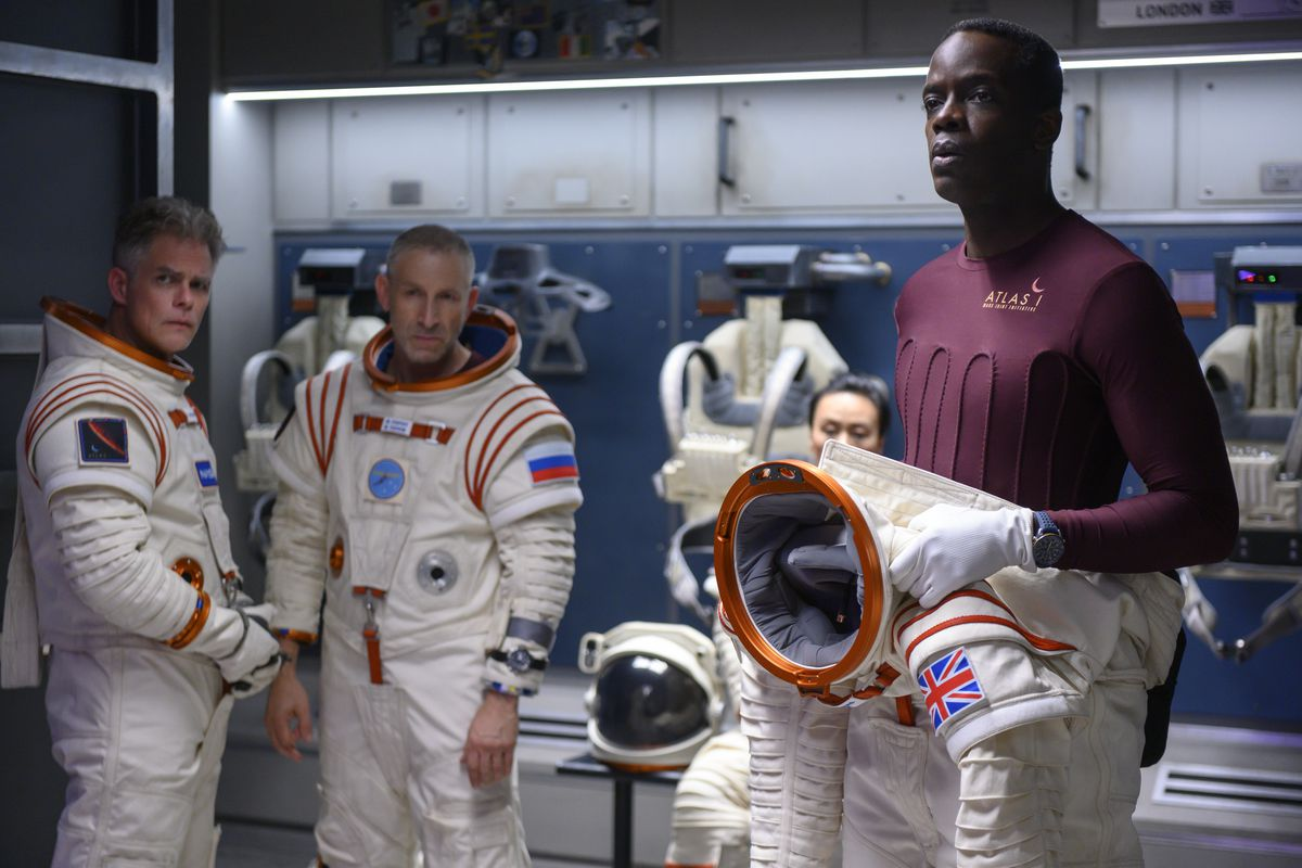 Away cast in their spacesuits