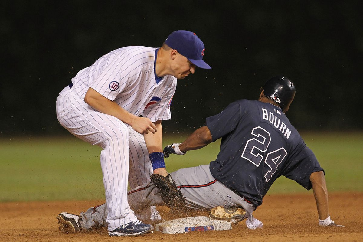 Michael Bourn of the Atlanta Braves steals second base as Jeff Baker of the Chicago Cubs applies the late tag at Wrigley Field on August 23, 2011 in Chicago, Illinois. (Photo by Jonathan Daniel/Getty Images)