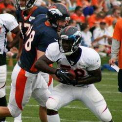 Peyton Manning hands off to rookie RB Montee Ball during the fifth day of training camp