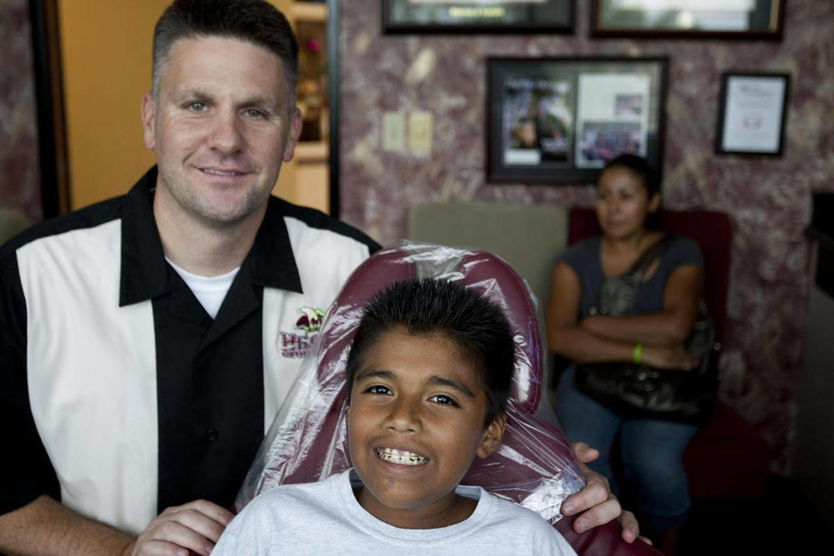 In this Sept. 10, 2012 photo, Juan Sanchez sits in the office of Michael Hilgers at Hilgers Orthodontics  in Litchfield Park, Ariz. The 11-year-old boy had what fellow students referred to as teeth that looked like a shark. His teeth were so gnarled he di