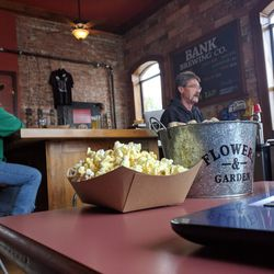 Every customer—EVERY PERSON—got a boat of popcorn and a full bucket of peanuts to eat as they pleased. I needed it, too; Bank's beers are boozy.