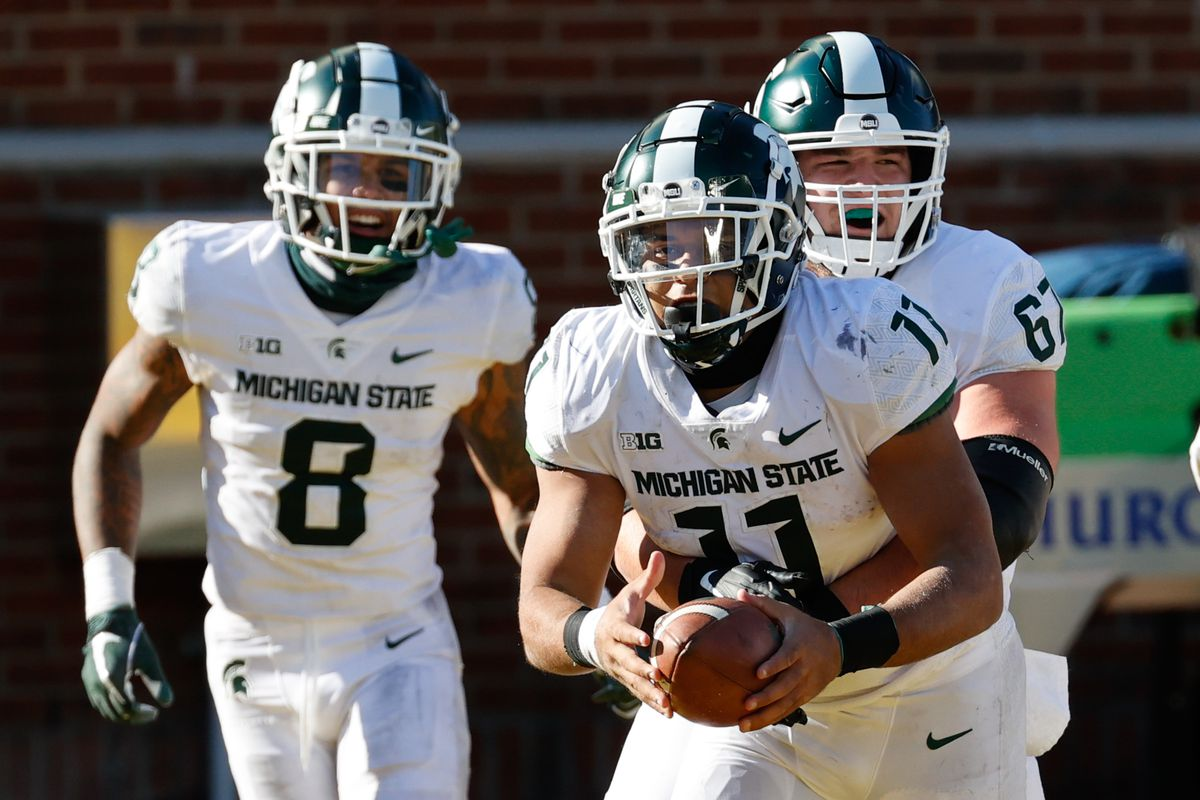 Michigan State Spartans running back Connor Heyward celebrates after scoring in the second half against the Michigan Wolverines at Michigan Stadium.