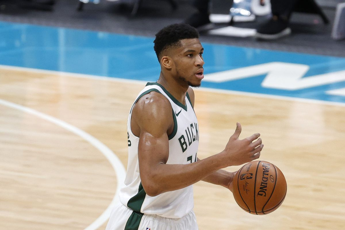 Giannis Antetokounmpo of the Milwaukee Bucks brings the ball up court during the third quarter of their game against the Charlotte Hornets at Spectrum Center on January 30, 2021 in Charlotte, North Carolina.