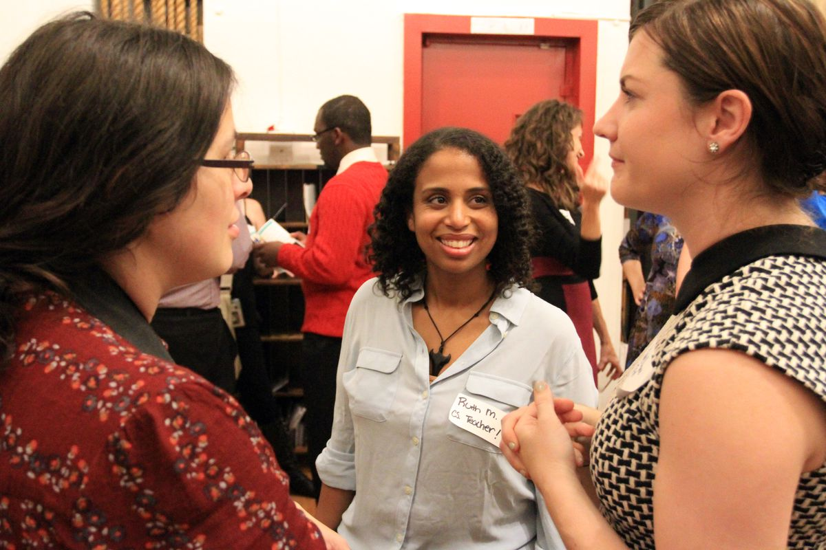 Ruth Mesfun, a computer science teacher at Excellence Girls Charter School Middle Academy (middle) speaks with Chalkbeat Managing Editor Philissa Cramer (left) and Teach for America communications director Katie Ware.