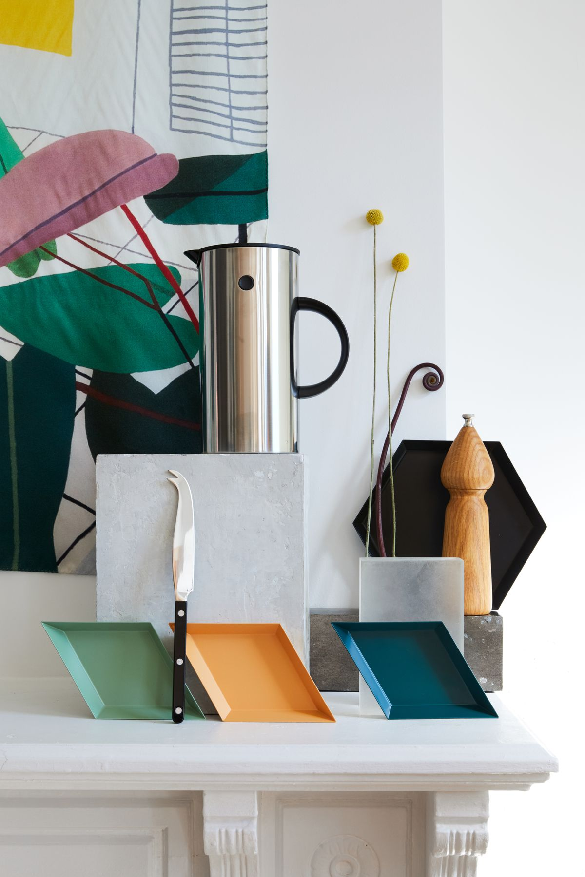 A coffee maker, serving trays, and other kitchen accessories.