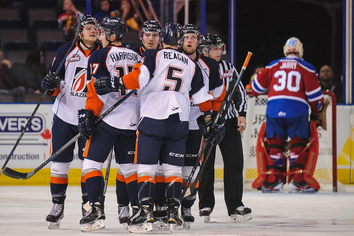 A group of Kamloops Blazers, none of them Ully, celebrate a goal.