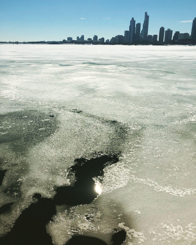 Ice along the Lake Michigan coast is seen melting Feb. 23, 2021.