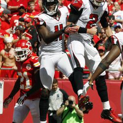Atlanta Falcons quarterback Matt Ryan (2) and wide receiver Julio Jones (11) celebrate a touchdown as Kansas City Chiefs defensive back Javier Arenas (21) returns to the bench during the second half of an NFL football game at Arrowhead Stadium in Kansas City, Mo., Sunday, Sept. 9, 2012.