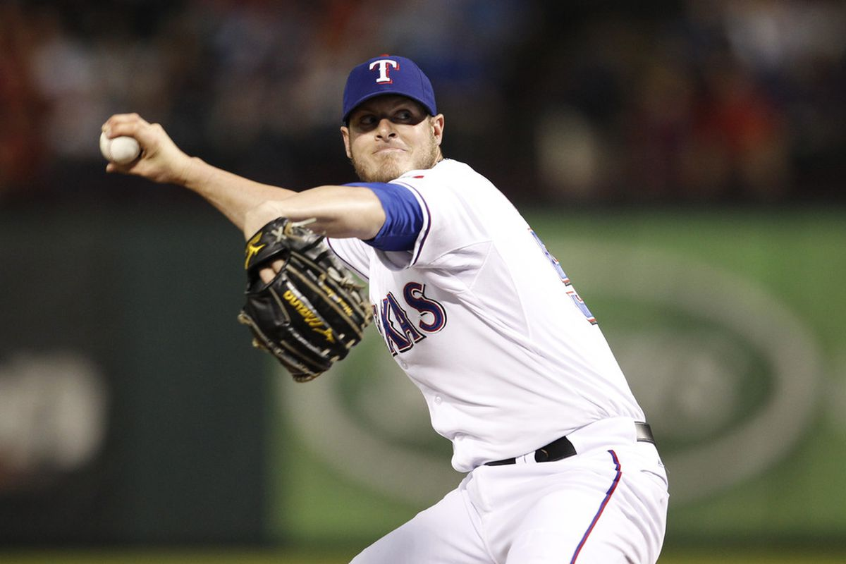 May 11, 2012; Arlington, TX, USA; Texas Rangers relief pitcher Mark Lowe (57) throws to the Los Angeles Angels in the sixth inning at Rangers Ballpark in Arlington. Mandatory Credit: Jim Cowsert-US PRESSWIRE