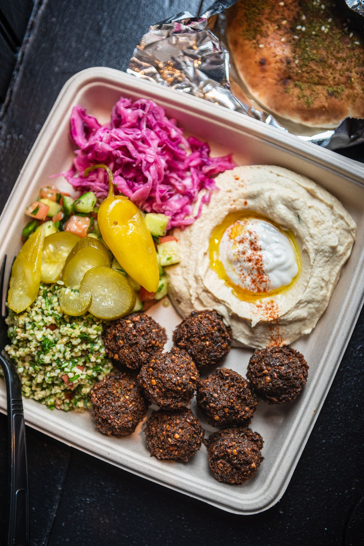 A falafel platter from Taïm features a hearty scoop of hummus