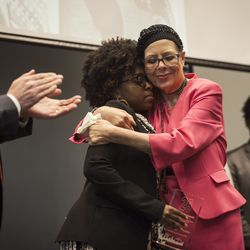 Karen Lewis, president of the Chicago Teachers Union, hugs Charlene Carruthers, national director of the Black Youth Project 100, after she received the 26 Award at the union's Martin Luther King Education Justice Breakfast at the IUOE Local 399 Hall, Friday, Jan. 15, 2016.