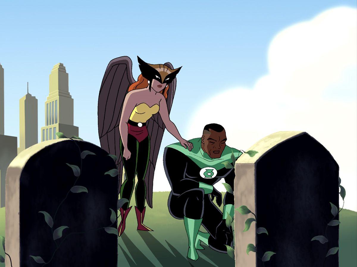 Green Lantern John Stewart takes a knee at a grave as Hawkgirl consoles him