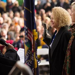 Salt Lake County presiding Judge Shauna Graves-Robertson administers the oath of office to Jackie Biskupski during a ceremony outside the City-County Building on Monday, Jan. 4, 2016. Standing next to Biskupski is the new mayor's fiancÉe, Betty Iverson.