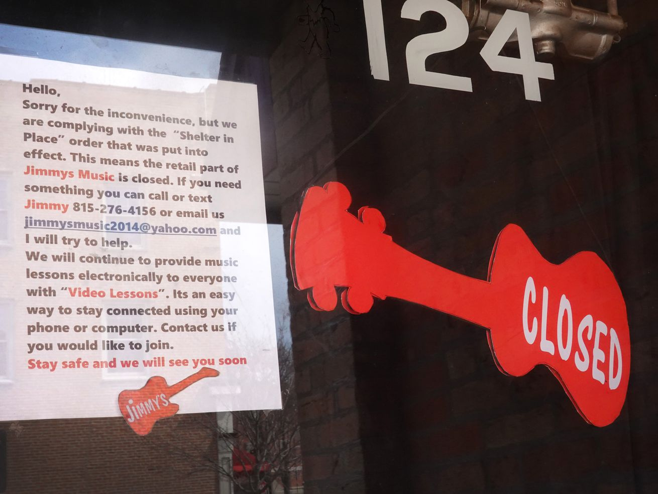 A sign on the front door of Jimmy's Music explains why the business is closed on April 06, 2020 in Woodstock, Illinois.