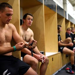 Aaron Cruden and Ben Smith sit in the dressing room following the first test match between the New Zealand All Blacks and France.