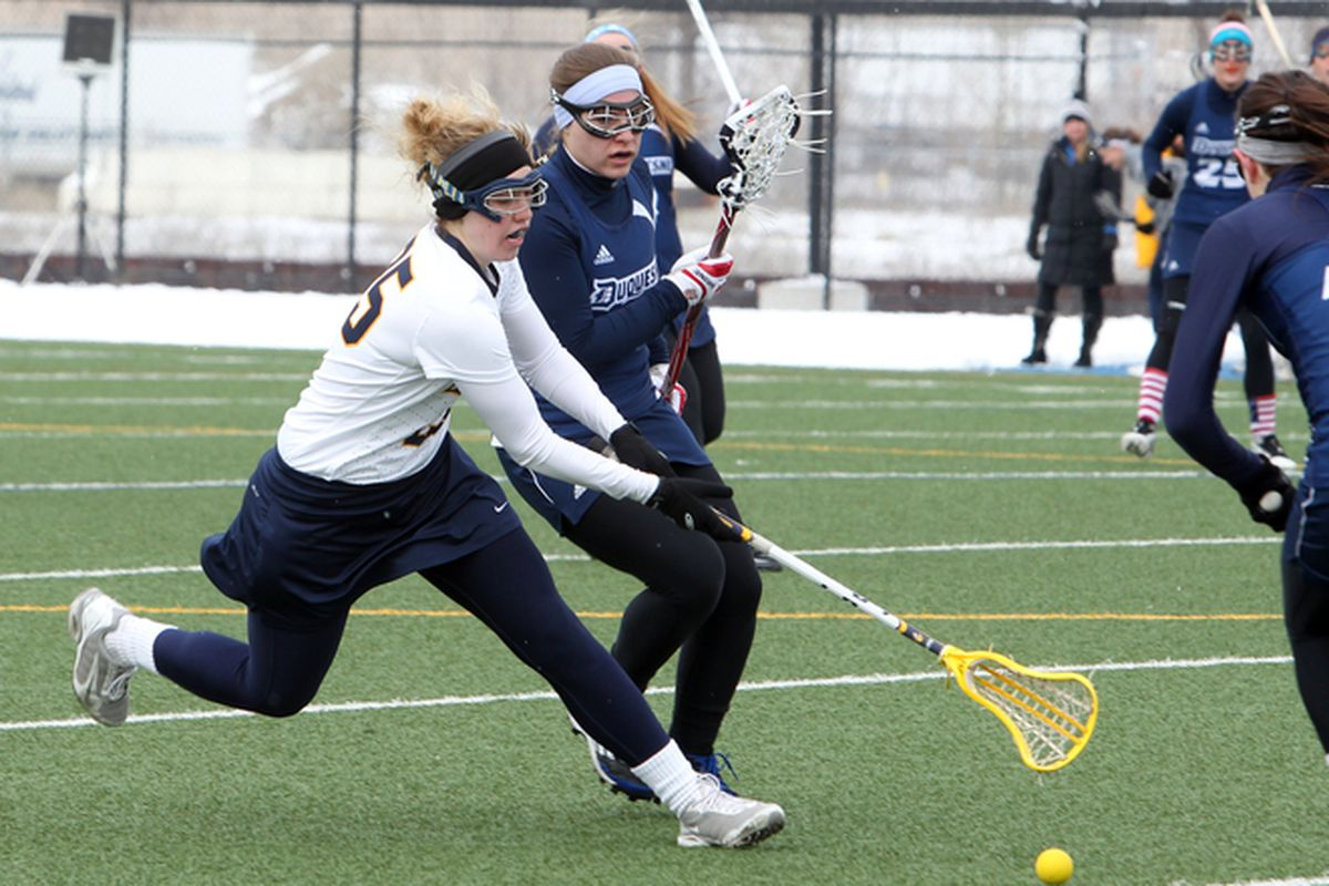 Elisabeth Goslee doing what Marquette does: getting after ground balls.