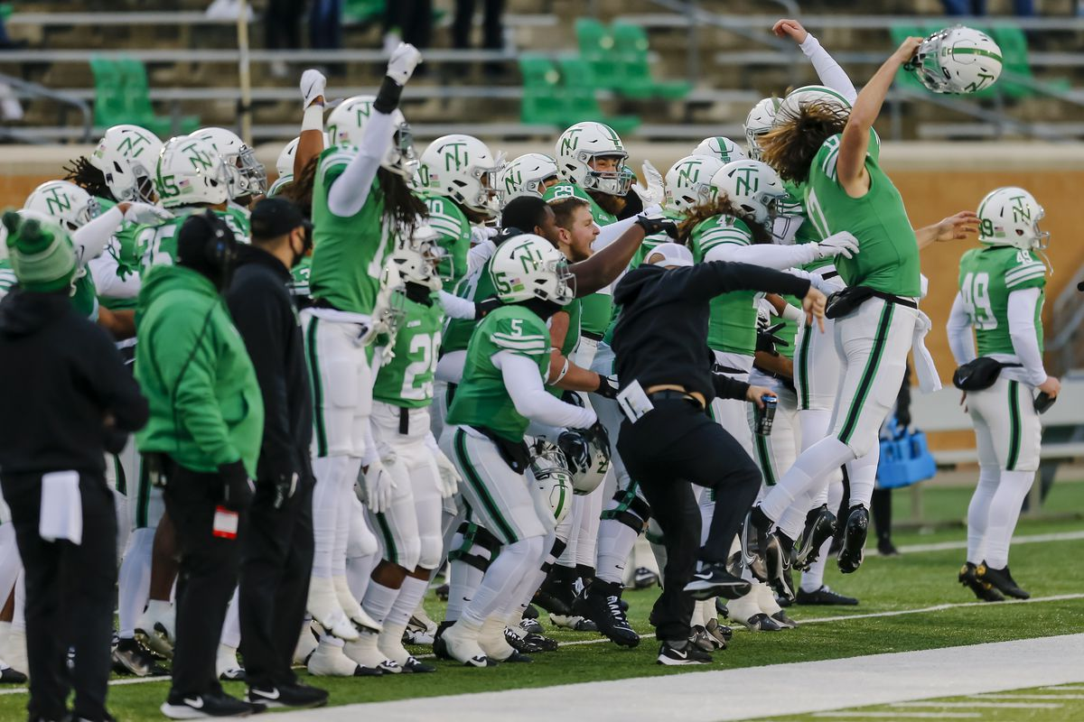 The North Texas Mean Green team jumps up and down before the kickoff between the North Texas Mean Green and the Louisiana Tech Bulldogs on Thursday 3, 2020 at Apogee Stadium in Denton, Texas.