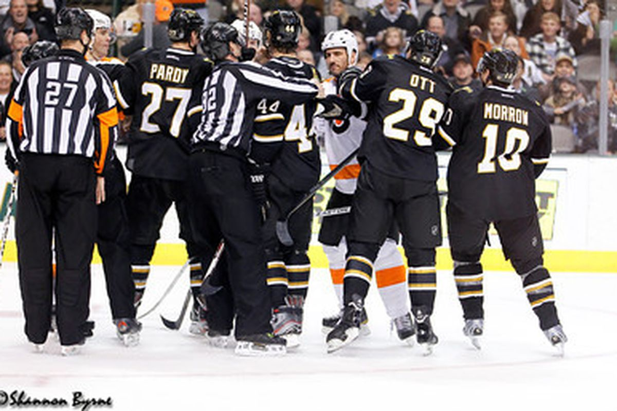 There was a lot of this after whistles.   Photo courtesy of Shannon Byrne of www.myhockeyshots.com
