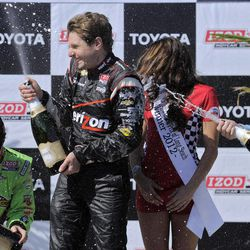 Simon Pagenaud, right, of France, sprays champagne on Will Power, center, of Australia, next to James Hinchcliffe, left, of Canada, after the IndyCar Series' Toyota Grand Prix of Long Beach auto race, Sunday, April 15, 2012, in Long Beach, Calif. Power took first, Pagenaud second and Hinchcliffe third.