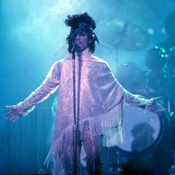 Fringed turtleneck poncho: Words that somehow make sense when Prince is involved.