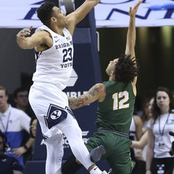 Brigham Young Cougars forward Yoeli Childs (23) blocks the shot by San Francisco Dons guard Trevante Anderson (12) in Provo on Saturday, Feb. 8, 2020. BYU won 90-76.