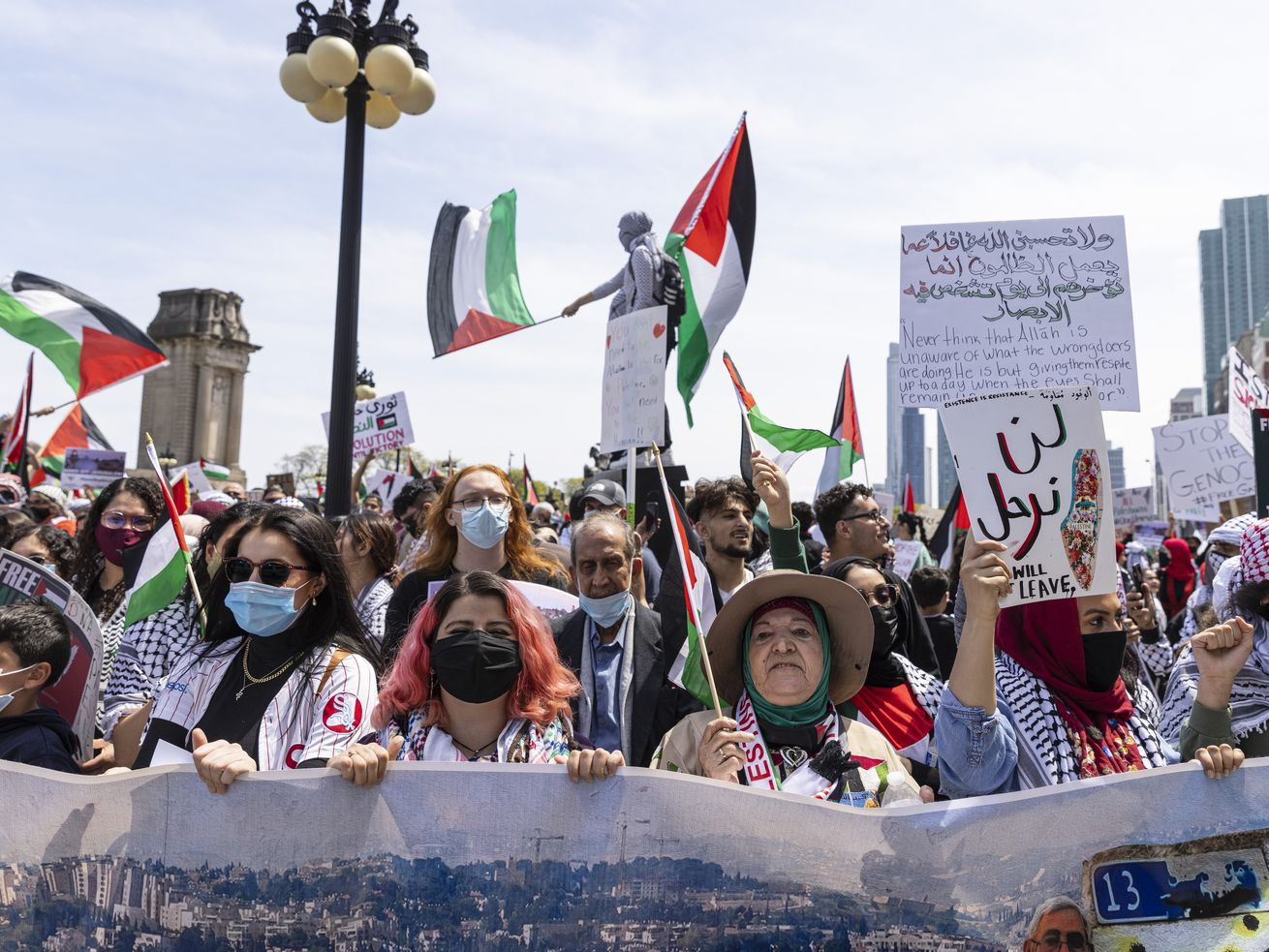 Supporters hold up flags and posters during a rally and march in support of Palestinians at Congress Plaza Garden in the Loop in response to an ongoing assault between Israelis and Palestinians in the middle east, Sunday, May 16, 2021. | Anthony Vazquez/Sun-Times