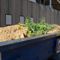 11:33 a.m. All the leftover sand has been shoveled into the dumpster -