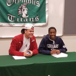 Olympus football players Cameron Latu and Brach Davis sign their letters of intent to play at Alabama and BYU, respectively.