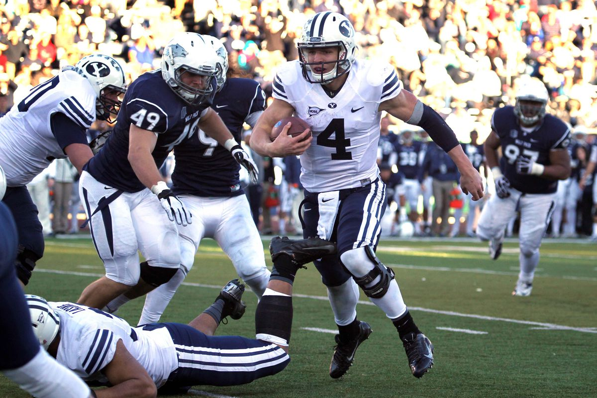 Taysom Hill, running for a touchdown against Nevada, could be the next Cougar picked in the NFL Draft