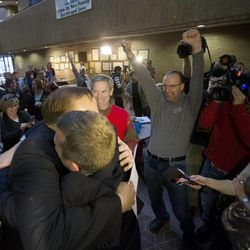 State Sen. Jim Dabakis and his husband, Stephen Justesen, embrace after being married by Salt Lake City Mayor, Ralph Becker as hundreds turn out to obtain marriage licenses Friday, Dec. 20, 2013 in the Salt Lake County offices after a Federal judge ruled that Amendment 3, Utah's same-sex marriage ban, is unconstitutional.