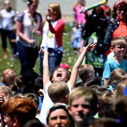 Students cheer as they are sprayed with confetti on the last day of school at Crestview Elementary in Holladay on Friday, May 27, 2016.