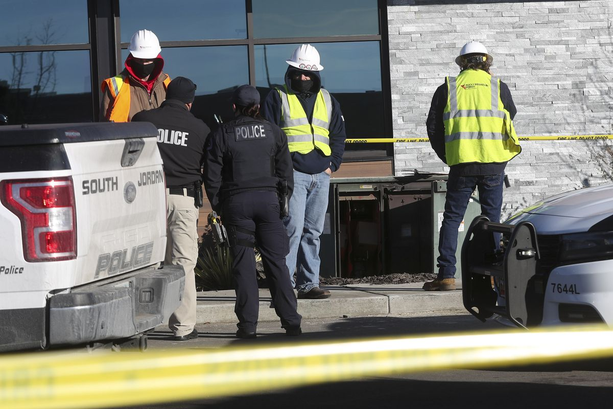 South Jordan Police and Rocky Mountain Power officials investigate a possible electrocution at a construction site near 11400 South and 3400 West in South Jordan on Monday, Jan. 4, 2021.