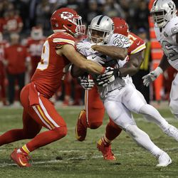 Oakland Raiders running back DeAndre Washington (33) is tackled by Kansas City Chiefs defensive back Daniel Sorensen, left, and defensive end Allen Bailey during the first half of an NFL football game in Oakland, Calif., Thursday, Oct. 19, 2017. (AP Photo/Marcio Jose Sanchez)