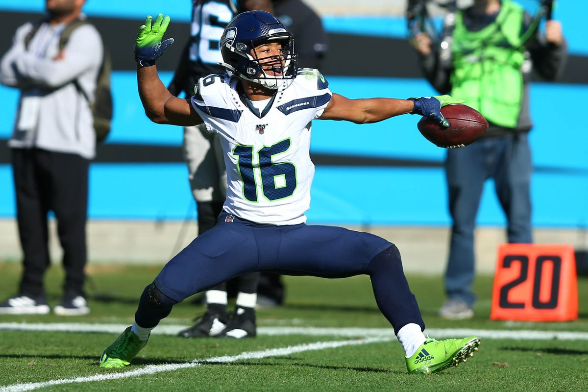Seattle Seahawks wide receiver Tyler Lockett (16) reacts after a first down in the first quarter against the Carolina Panthers at Bank of America Stadium.