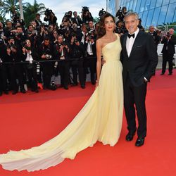 Amal Clooney, wearing an Atelier Versace gown and Cartier drop earrings, and George Clooney at the 'Money Monster' premiere.
