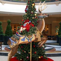 Twenty life-sized decorated reindeer greet shoppers at the mall's entrances.