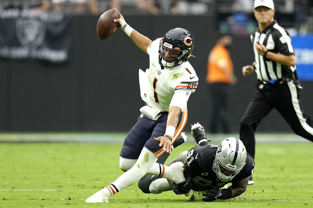 Bears quarterback Justin Fields runs with the ball against the Raiders on Sunday.