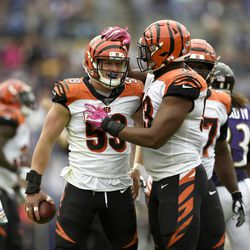 Cincinnati Bengals outside linebacker Nick Vigil (59) is congratulated by defensive tackle Andrew Brown (93) after recovering a fumble by Baltimore Ravens tight end Mark Andrews during the first half of a NFL football game Sunday, Oct. 13, 2019, in Baltimore. Vigil signed with the Chargers in the offseason.