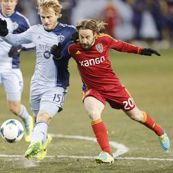 Kansas City's Seth Sinovic battles Real's Ned Grabavoy for the ball as Real Salt Lake and Sporting KC play Saturday, Dec. 7, 2013 in MLS Cup action. Sporting KC won in a shootout.