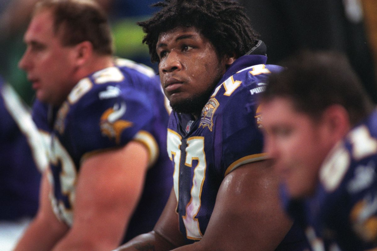 GENERAL INFORMATION: Korey Stringer photos from the 2000 season IN THIS PHOTO: Minnesota Viking right tackle Korey Stringer, center, sits on the bench with teammate Corbin Lacina, left, during a game against the New Orleans Saints at the Metrodome in Jan