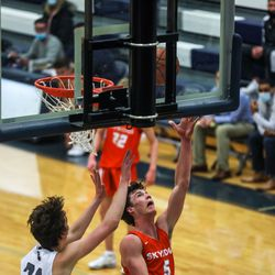 Skyridge and Corner Canyon compete in a boys basketball game in Draper on Friday, Jan. 15, 2021.