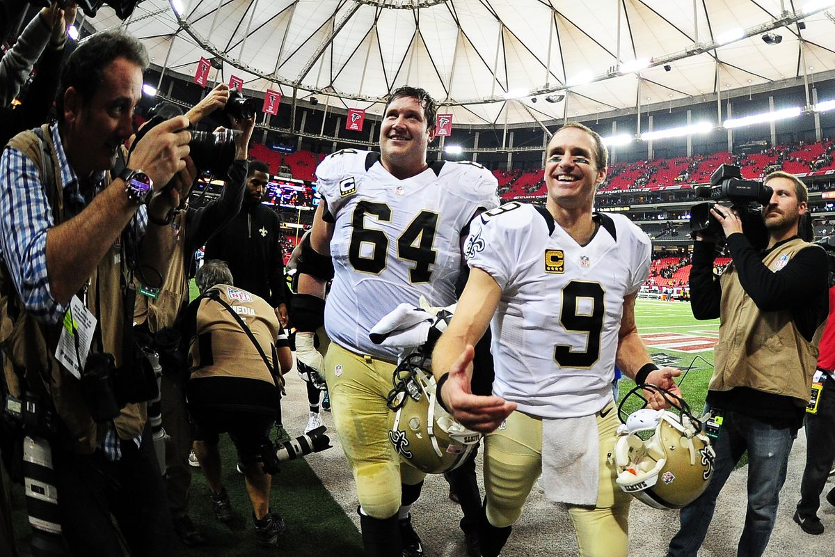 ATLANTA, GA - New Orleans Saints right tackle Zach Strief (64) and quarterback Drew Brees (9) celebrate as they leave the field after beating the Atlanta Falcons at the Georgia Dome in 2016.