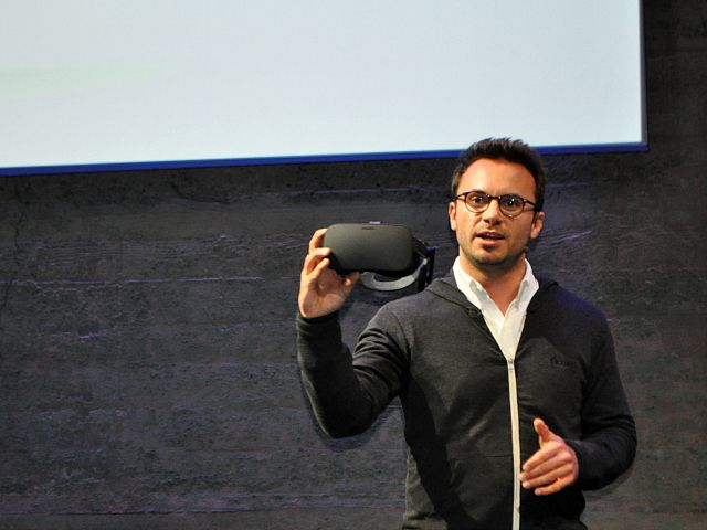 Oculus CEO Brendan Iribe shows off the Oculus Rift at a press event in San Francisco.