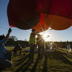 A balloon carrying a camera is readied to capture more than 1,000 participants set a world record for the largest live Nativity, Monday, Dec. 1, 2014, at Rock Canyon Park in Provo.