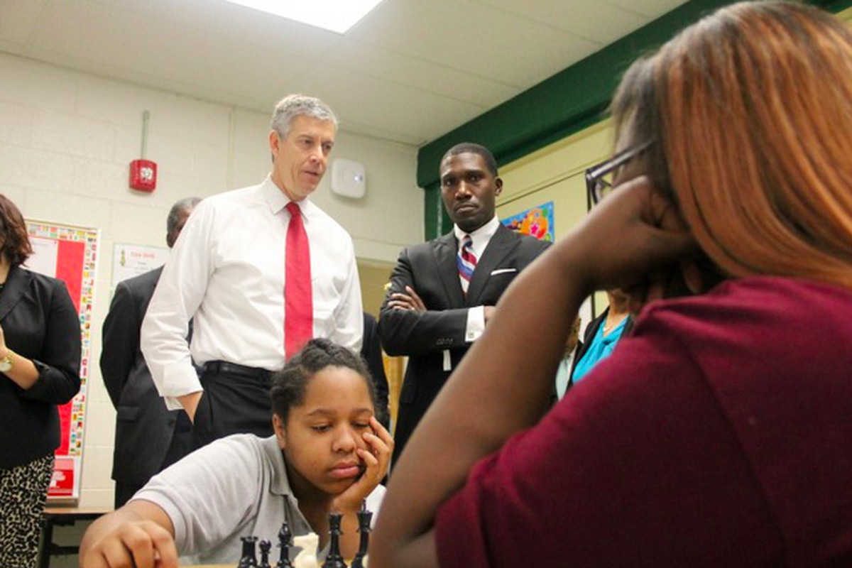 Then-U.S. Education Secretary Arne Duncan talks with students and their principal on a visit to Tennessee in October.