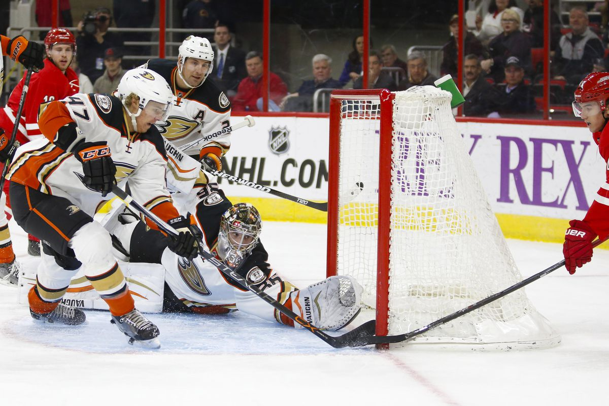 Hampus Lindholm helps John Gibson deny Victor Rask during the second period at PNC Arena.