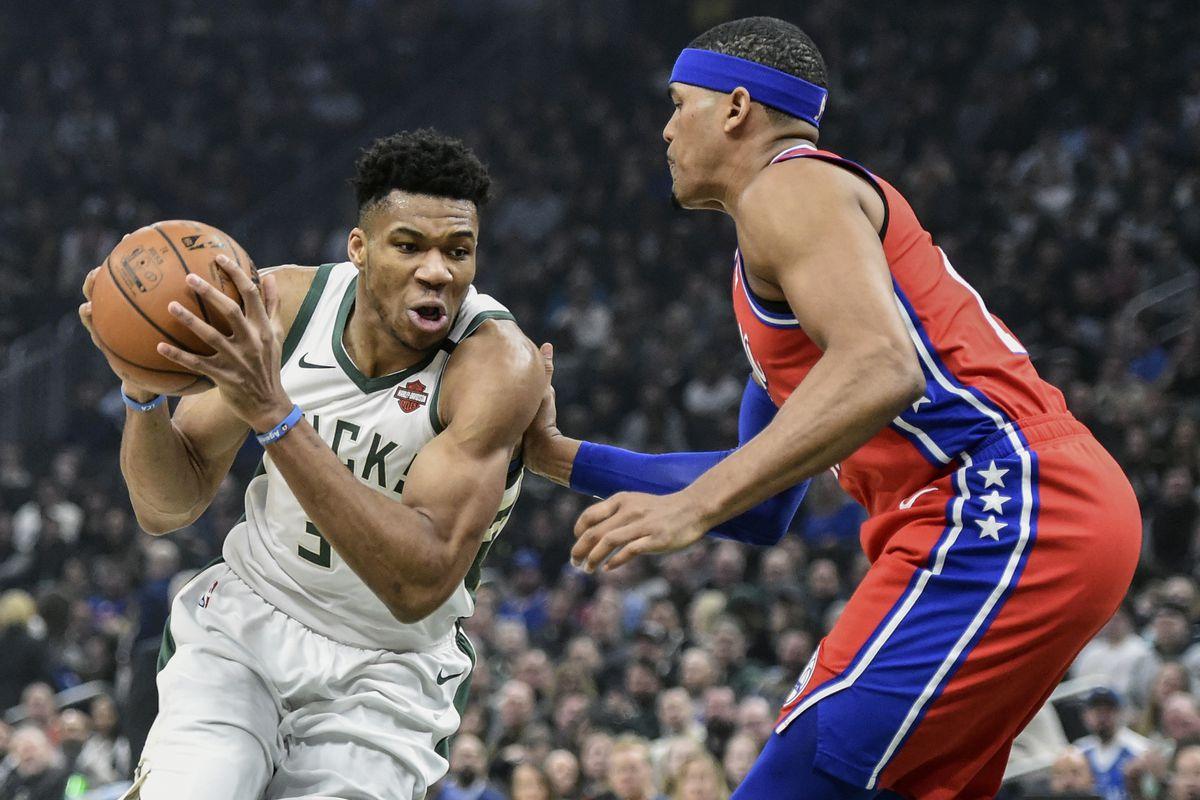 Milwaukee Bucks forward Giannis Antetokounmpo drives for the basket against Philadelphia 76ers forward Tobias Harris in the first quarter at Fiserv Forum.