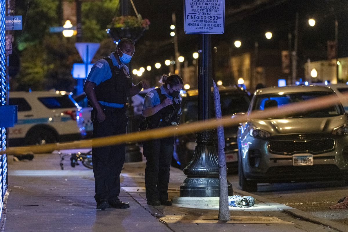 Chicago police work the scene where at least six people were shot in the 2000 block of East 71st Street in the South Shore neighborhood, late Sunday, June 27, 2021.